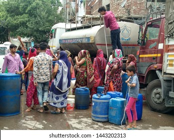 Delhi, India , 2019 : Water crisis. People queued in front of water truck waiting for their turn.