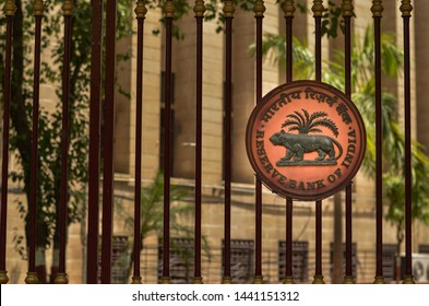Delhi, India, 2020. RBI logo on the closed iron gate of Reserve Bank of India (RBI) building at Patel Chowk, Connaught Place with the office building in the background.