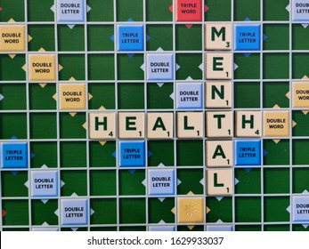Delhi, India : 2020 Scrabble tiles used to spell the words mental health on the game board. Scrabble is owned by the toy company mattel