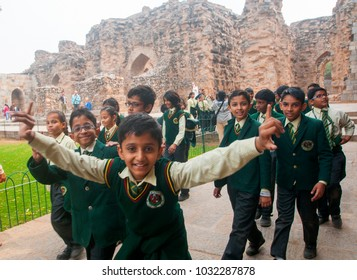 DELHI, INDIA - 23 FEBRUARY 2018 : Unidentified Tourist student at Qutub Minar,The tallest minaret in India is a marble and red sandstone tower,People like to visit regularly.UNESCO World Heritage site