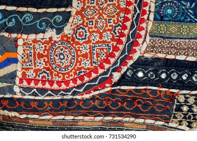 DELHI, INDIA - 5 OCT: Abstract lines of retro patchwork on old cotton blanket surface with flowers on 5 October, 2017. Cotton was domesticated in India by 4000 BCE.
