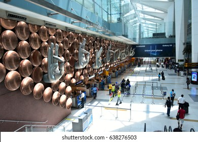 DELHI, INDIA - 8 APR 2017 : Art of the Nine Mudras by Ayush Kasliwa inside the terminal at the Indira Gandhi International Airport (DEL) in Delhi, India . It is the busiest airport in India.