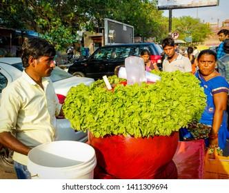 Delhi, India - april 21 2019 a street vendor selling jal-jeera in old Delhi