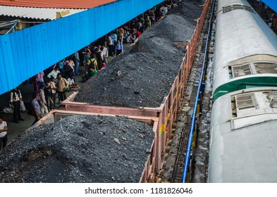 Delhi / India - August 10, 2012: Coal train waiting at station in India.