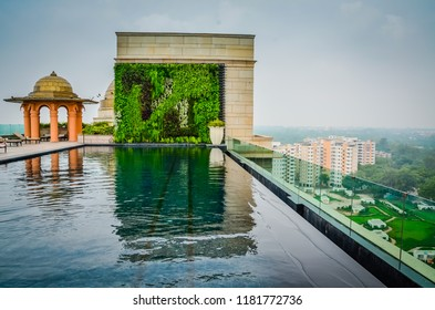 Delhi / India - August 8, 2012: Empty infinity pool on rooftop terrace of Leela Palace Hotel overlooking New Delhi, India.