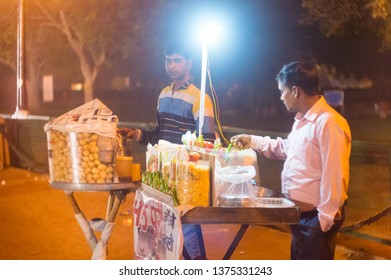 Delhi, India - Circa 2017: Street food vendors near the india gate delhi at night. Shows a selection of snacks liks bhel puri and namkeen savories which are a favorie with the people who visit the