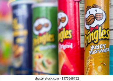 Delhi, India - Circa 2019: Colorful packaging of the top chip FMCG brands in indian retail stores. These brands from some of the top companies grace shelves in grocery, modern trade, mom and pop and
