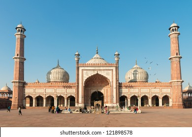 DELHI, INDIA - DECEMBER 1: people walks in the courtyard of Jama Masjid, a major tourist attraction and the largest and best known mosque in india on Dec 01, 2012 in Delhi, India