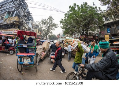 Delhi, India - December 11, 2017: crowd and traffic on street at Chandni Chowk, Old Delhi, famous travel destination in India. Chaotic city life, working people, fisheye ultra wide view.