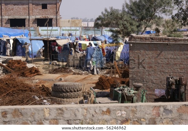 DELHI, INDIA - FEB. 14.: Camp of homeless people in the slums of Delhi, India on February 14. 2010