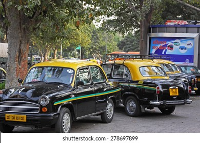 DELHI, INDIA   FEBRUARY 27, 2015: Ambassador cabs at a taxi stand. This particular model has been a feature of Indian cities for 60 years but its maker, Hindustan Motors, recently ended its production