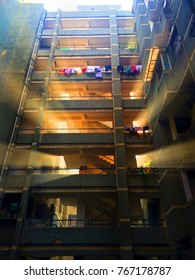 DELHI, INDIA - JANUARY, 2017: the sunshine getting through the building. The multi-storey building in India. The clothes dry on a balcony.