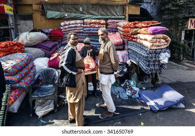 DELHI, INDIA - JANUARY 5, 2015: People on local textile market on January 5, 2015 in Delhi, India
