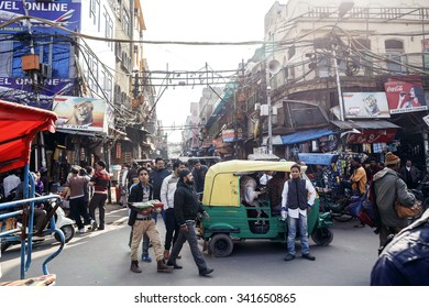 DELHI, INDIA - JANUARY 5, 2015: Local people on street on January 5, 2015 in Delhi, India