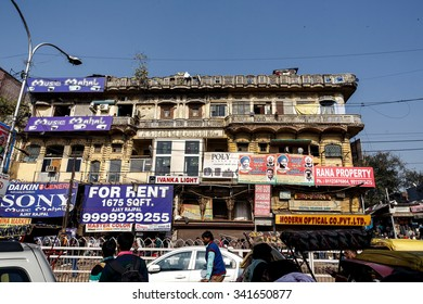DELHI, INDIA - JANUARY 5, 2015: Old, rusty building with advertisement on January 5, 2015 in Delhi, India