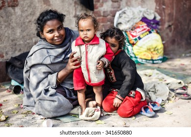 DELHI, INDIA - JANUARY 5, 2015: Poor Indian family of mother and two daughters on January 5, 2015 in Delhi, India