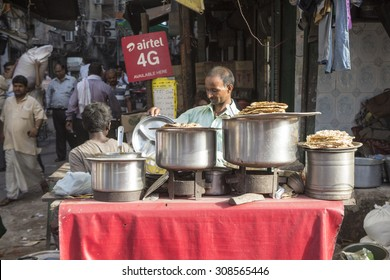 DELHI INDIA - JUL 7 :  parantha stall in spice market in old delhi. parantha is general street food in delhi on july, 15, 2015, india