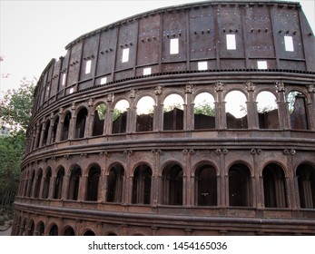 Delhi, Delhi / India - July, 08, 2019 : Side view of Replica of Colosseum, a huge ellipse, of Rome, made from waste material at Waste To Wonder Park, Delhi, India