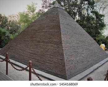 Delhi, Delhi / India - July, 08, 2019 : Replica of the Great Pyramid of Giza made from waste material at Waste To Wonder Park, Delhi, India