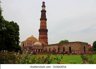 DELHI, INDIA - JULY 20, 2015: The people visit to Qutub Minar, one of UNESCO world heritag site, built in the early 13th century located on south of Delhi, India. JULY 20 2015