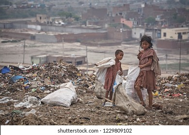 Delhi, India, July 2009. Children at work picking up rubbish at a dump on the outskirts of the city.