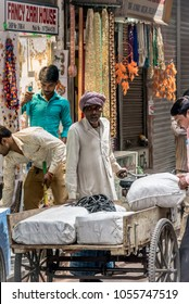 DELHI, INDIA - March 14, 2018: A Man Hand Delivering Goods from his Cart in a Market in Delhi India