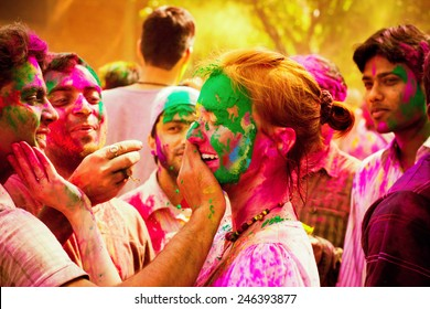 DELHI, INDIA - MARCH 20: Tourist with students of Jawaharlal Nehru University celebrate festival Holi on March 20, 2011 in Delhi, India. Holi is a spring festival celebrated as a festival of colours.