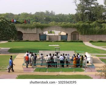 Delhi, India - May 01 2006: crowd visiting Raj Ghat in Gandhi Samadhi Area on a sunny day