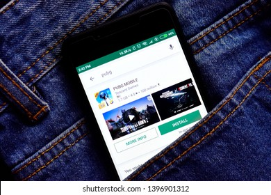 Delhi, india, May 13, 2019: pubg app on play store, pubg game application icon on smartphone in jeans pocket.