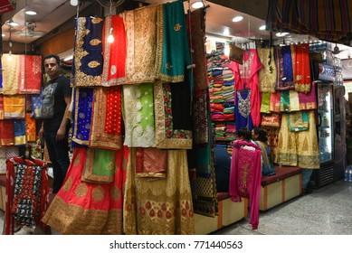 05beb1459b DELHI, INDIA - MAY 14: Sales man at shop selling traditional Indian dress  cotton
