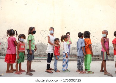 Delhi, India - May 16 2020 : Poor children during food distribution by a charitable trust during Corona pandemic.