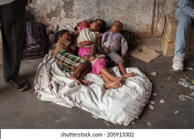 DELHI, INDIA MAY 2014 - Unidentified street children sleep on a train station on May 2014 in Delhi, India.