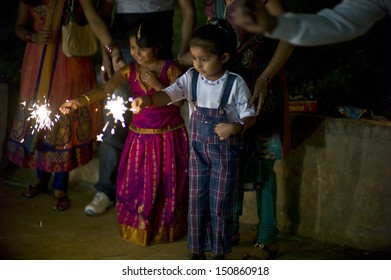 DELHI, INDIA - NOV 13: Unidentified children and adults are playing fire cracker on the festival Diwali on November 13, 2012 in Delhi, India.Diwali is the festival of light and is important to Indian.