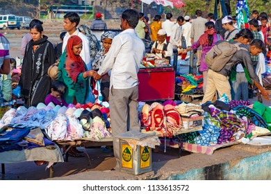 DELHI, INDIA - NOV 17, 2011: people go shopping at the central market Meena Bazaa.  Shah Jahan founded the bazaar in the 17th century inspired by the architecture of the Isfahan Bazaar.