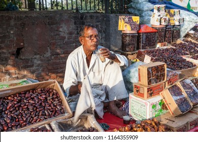 DELHI, INDIA - NOV 17, 2011: man sells figs at the central market Meena Bazaar.  Shah Jahan founded the bazaar in the 17th century inspired by the architecture of the Isfahan Bazaar.