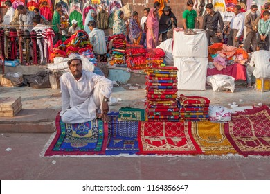 DELHI, INDIA - NOV 17, 2011: muslim man sells carpets for praying at   the central market Meena Bazaar.  Shah Jahan founded the bazaar in the 17th century inspired by the Isfahan Bazaar.