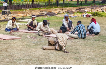 DELHI, INDIA - NOV 9, 2011: stone cutter work in the Red Fort in Delhi, India. Red Fort is a 17th century fort complex and was designated a UNESCO World Heritage Site in 2007.