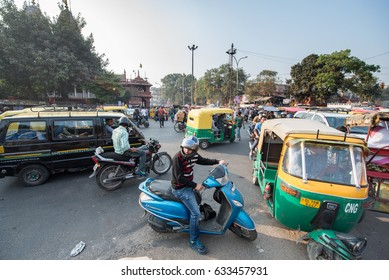 DELHI, INDIA - November 18, 2016: Vehicles and people at the busy Chandni Chowk market, Old Delhi, India, Southeast Asia.