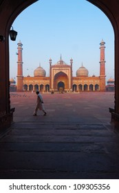 Delhi, India - November 19, 2009: A muslim man walks in the courtyard of Jama Masjid, a major tourist attraction and the largest mosque in india