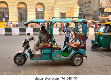 Delhi, India - November 20, 2017: An e-rickshaw or electronic rickshaw waiting for passengers in the road.