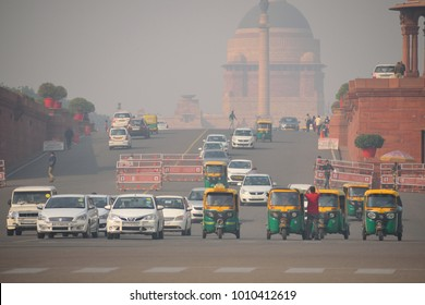 Delhi, India - November 21, 2017: Vehicles traveling on the road in heavy smog.
