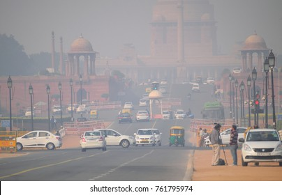 Delhi, India - November 21, 2017: Vehicles moving in the road amidst heavy smog.