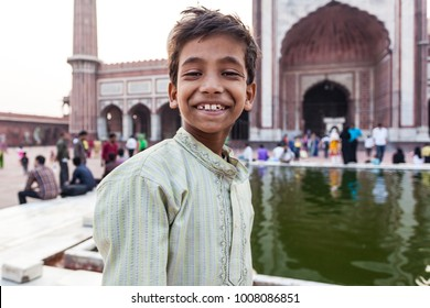 DELHI, INDIA - NOVEMBER 5, 2014: Portrait of an Indian boy in  the Jama Masjid of Delhi, one of the largest mosques in India.