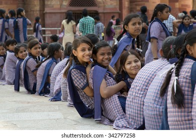 DELHI, INDIA - OCTOBER 11, 2015: unidentified local school girls for tour in Qutub Minar complex, Delhi, India, as part of national education. The girls in school uniform have fun posing for a photo.