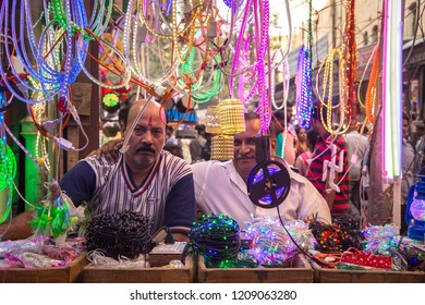 DELHI, INDIA - OCTOBER 17, 2018: Portrait of An Indian shopkeeper selling led lights on the ocassion of Diwali festival in India.