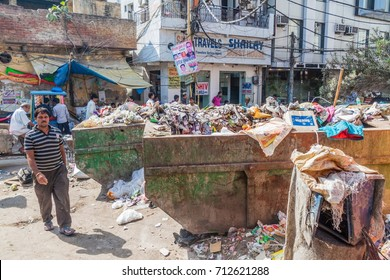 DELHI, INDIA - OCTOBER 22, 2016: Dumpsters full of garbage in the center of Delhi, India.