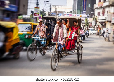 DELHI, INDIA - OCTOBER 29, 2013: Morning on a street  in Old Delhi, India. Indian capital still uses man powered rickshaws as a usual means of transport.