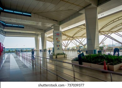 DELHI, INDIA - SEPTEMBER 19, 2017: Unidentified people walking with their lugages at the enter of the International Airport of Delhi, Indira Gandhi International Airport is the 32th busiest in the