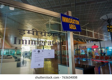 DELHI, INDIA - SEPTEMBER 19, 2017: Informative sign of inmigration area in the International Airport of Delhi, India Gandhi International Airport is the 32th busiest in the world