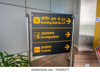 DELHI, INDIA - SEPTEMBER 19, 2017: Informative sign with yellow letters in black background in the exit of the International Airport of Delhi, India Gandhi International Airport is the 32th busiest in